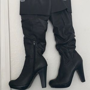 Black knee high, heeled boots